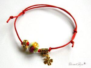 bratara-martisor-ceramica-pictata-flori-cristale-swarovski-trifoi-aurit-talisman-galben-unicatbiju